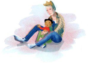 Barnet sitter mellan pappans ben